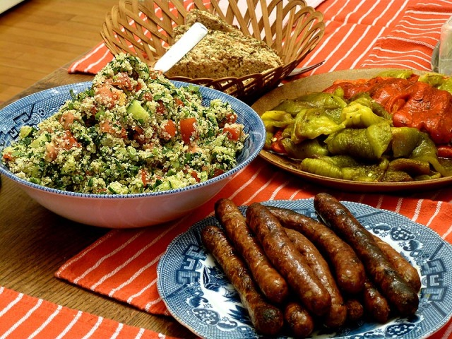 Dinner: tabouleh, grilled peppers, over-cooked merguez sausage and mom's bread